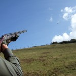 Roy shooting with cross over Purdey 28 bore